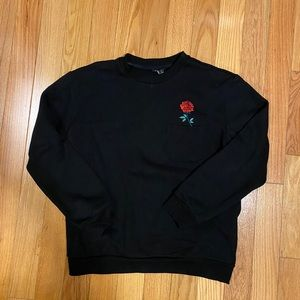 Sweater with pocket and embroidered rose